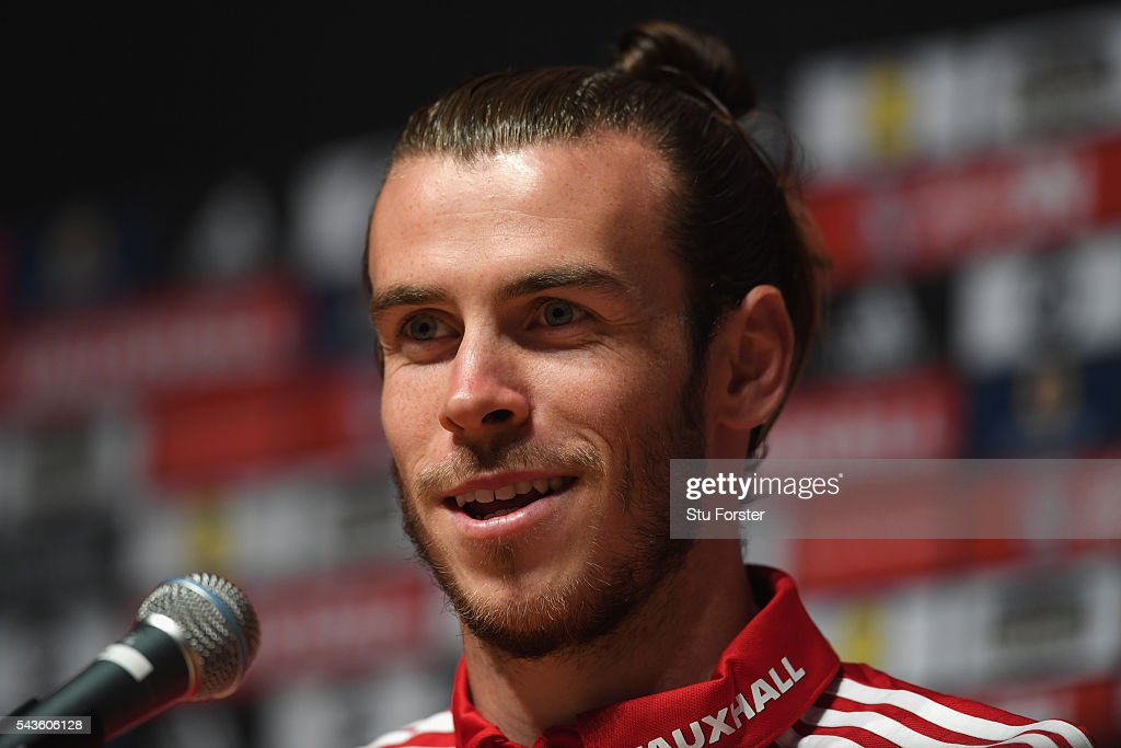 Wales player <a gi-track='captionPersonalityLinkClicked' href=/galleries/search?phrase=Gareth+Bale&family=editorial&specificpeople=609290 ng-click='$event.stopPropagation()'>Gareth Bale</a> faces the media at the Wales Press conference ahead of their quarter final match against Belguim at their Dinard training camp on June 29, 2016 in Dinard, France.