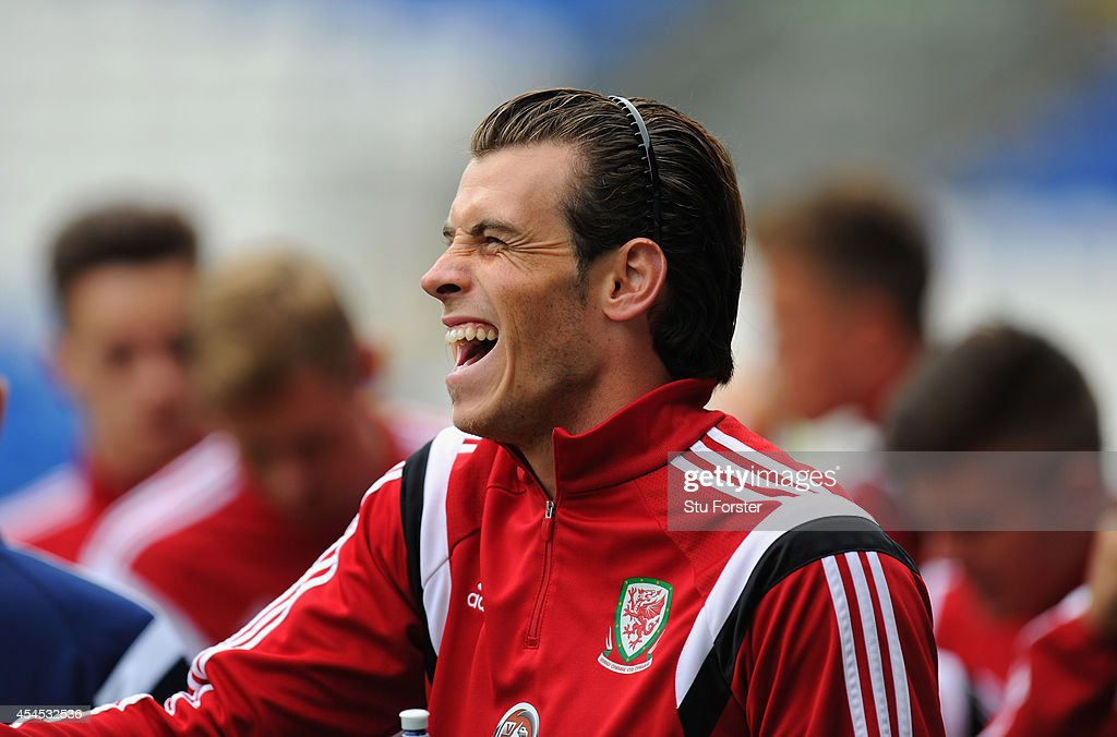 Wales player Gareth Bale has a laugh during a Wales training session at Cardiff City Stadium on September 3, 2014 in Cardiff, Wales.