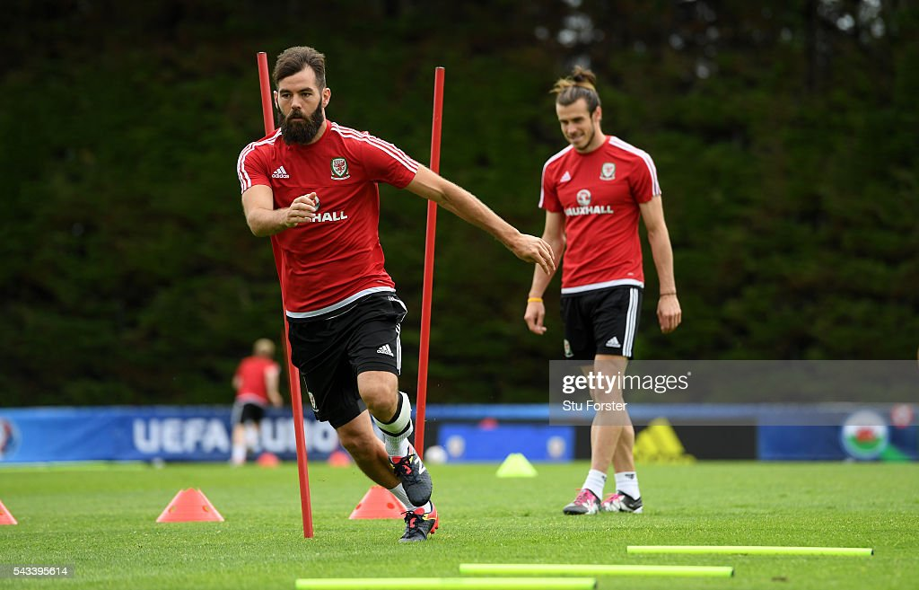 Wales player <a gi-track='captionPersonalityLinkClicked' href=/galleries/search?phrase=Gareth+Bale&family=editorial&specificpeople=609290 ng-click='$event.stopPropagation()'>Gareth Bale</a> (r) in action with <a gi-track='captionPersonalityLinkClicked' href=/galleries/search?phrase=Joe+Ledley&family=editorial&specificpeople=687410 ng-click='$event.stopPropagation()'>Joe Ledley</a> during Wales training at their Euro 2016 base camp ahead of their Quarter Final match against Belguim, on June 28, 2016 in Dinard, France.
