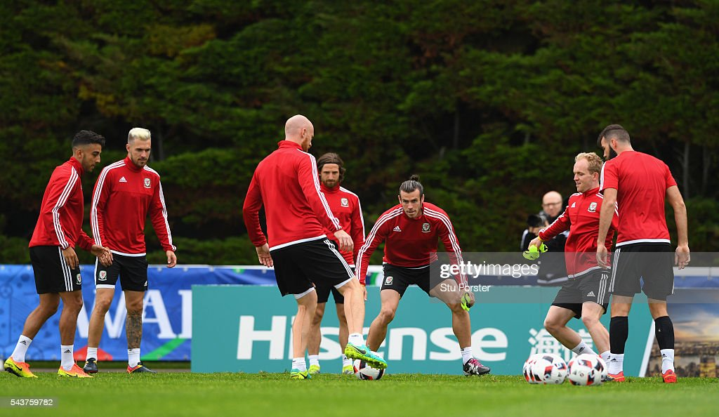 Wales player <a gi-track='captionPersonalityLinkClicked' href=/galleries/search?phrase=Gareth+Bale&family=editorial&specificpeople=609290 ng-click='$event.stopPropagation()'>Gareth Bale</a> (c) in action with team mates during Wales training session ahead of their Euro 2016 quarter final match against Belgium at their base camp on June 30, 2016 in Lille, France.