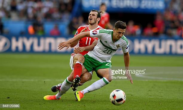Wales player Gareth Bale is challenged by Craig Cathcart of Northern Ireland the Round of 16 UEFA Euro 2016 match between Wales and Northern Ireland...