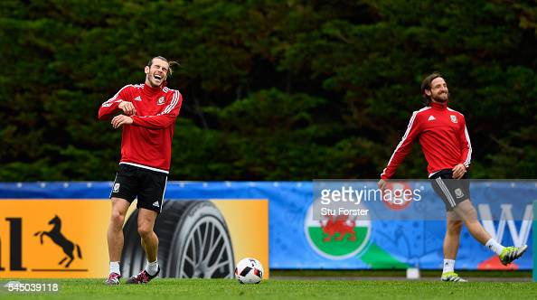 Wales player Gareth Bale laughs with Joe Allen during Wales training ahead of their UEFA Euro 2016 Semi final against Portugal at College Le Bocage...