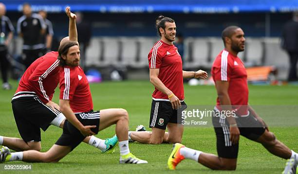 Wales player Gareth Bale raises a smile as Joe Allen and Ashley Williams stretch during Wales training at Nouveau Stade de Bordeaux ahead of their...
