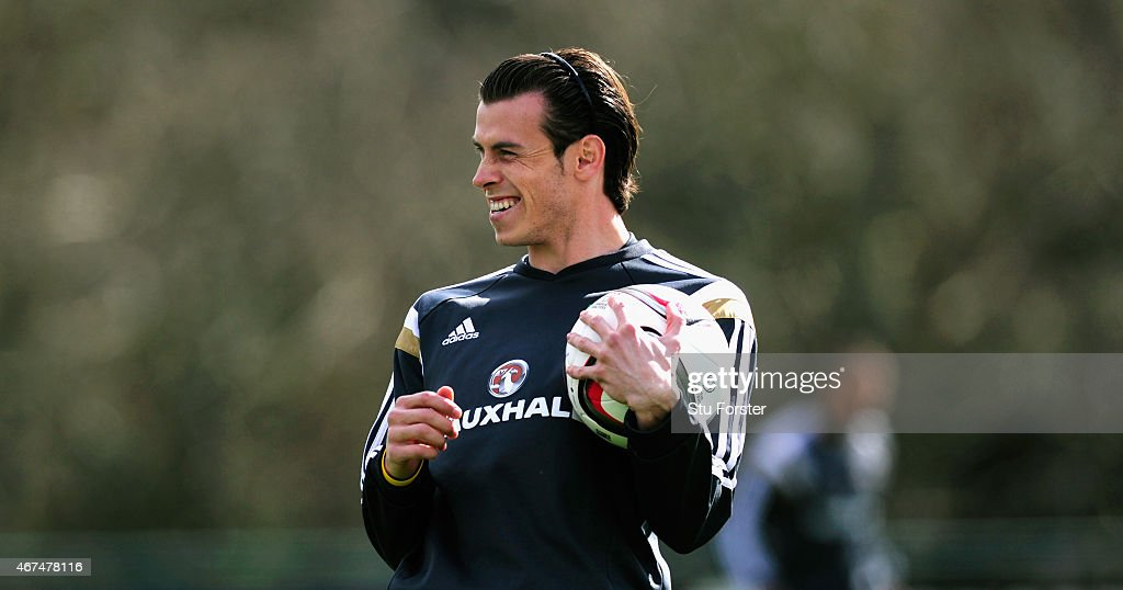 Wales player Gareth Bale raises a smile during training ahead of this weekend's game against Israel at the Vale Hotel on March 25, 2015 in Cardiff, Wales.