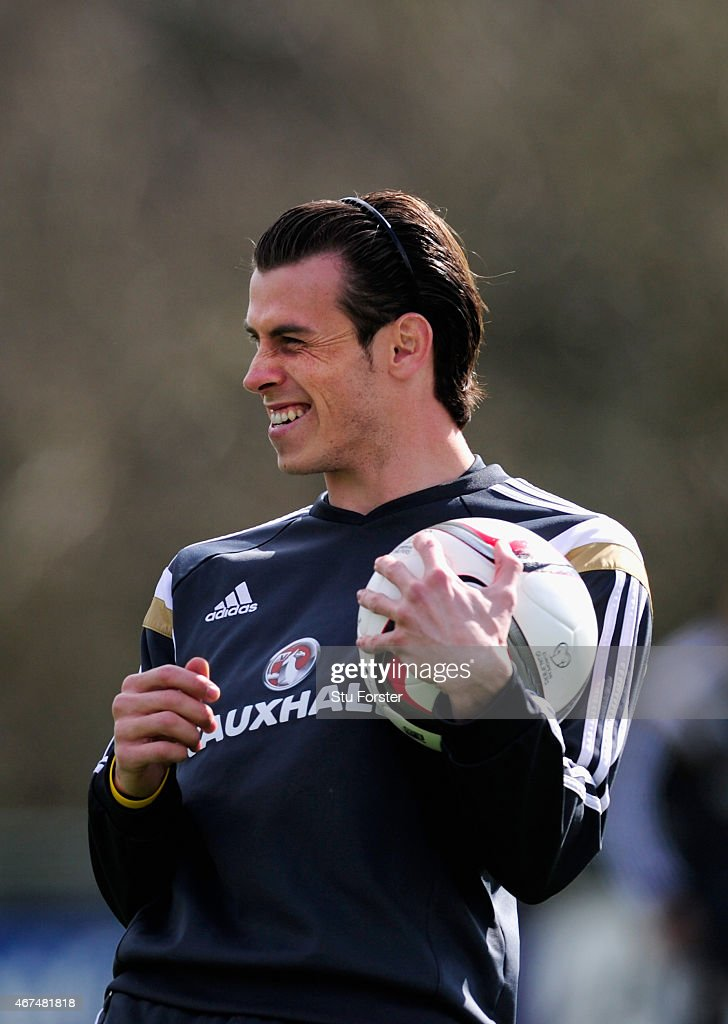 Wales player <a gi-track='captionPersonalityLinkClicked' href=/galleries/search?phrase=Gareth+Bale&family=editorial&specificpeople=609290 ng-click='$event.stopPropagation()'>Gareth Bale</a> raises a smile during training ahead of this weekend's game against Israel at the Vale Hotel on March 25, 2015 in Cardiff, Wales.