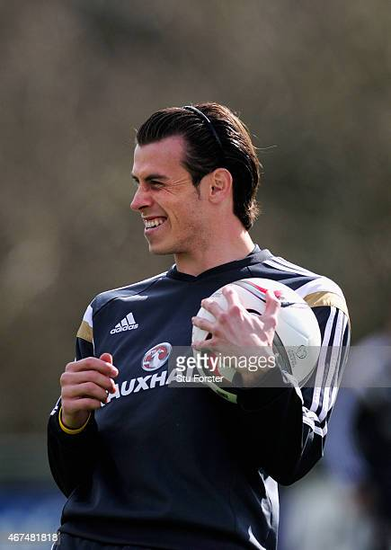 Wales player Gareth Bale raises a smile during training ahead of this weekend's game against Israel at the Vale Hotel on March 25 2015 in Cardiff...