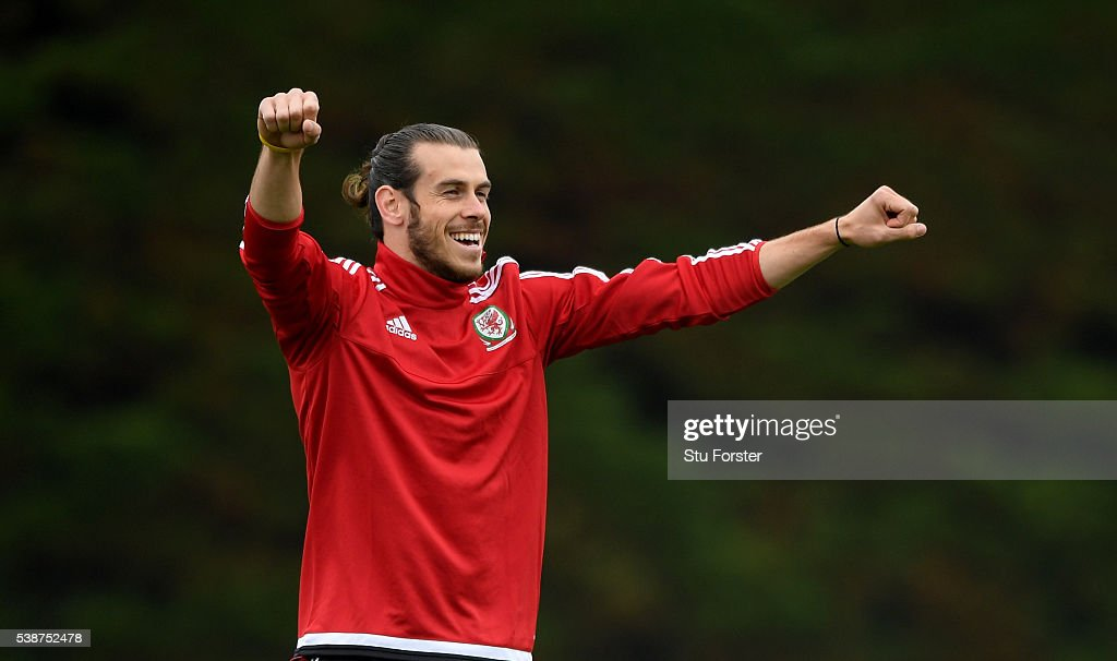 Wales player <a gi-track='captionPersonalityLinkClicked' href=/galleries/search?phrase=Gareth+Bale&family=editorial&specificpeople=609290 ng-click='$event.stopPropagation()'>Gareth Bale</a> reacts during an open Euro 2016 Wales training session at the Wales training base on June 8, 2016 in Dinard, France.