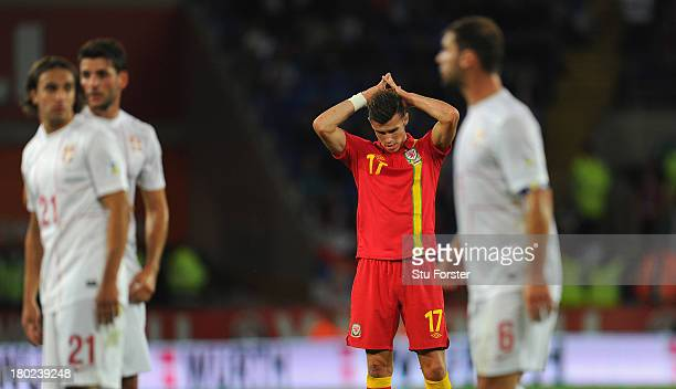 Wales player Gareth Bale reacts during the FIFA 2014 World Cup Qualifier Group A match between Wales and Serbia at Cardiff City Stadium on September...