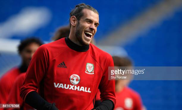 Wales player Gareth Bale shares a joke during Wales training ahead of their FIFA 2018 World Cup Qualifier against Austria at Cardiff City Stadium on...