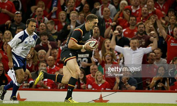 Wales player George North runs in the first try during the International match between Wales and Ireland at Millennium Stadium on September 5 2015 in...