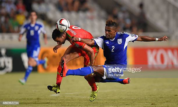 Wales player Hal RobsonKanu is challenged by Dossa Junior of Cyprus during the UEFA EURO 2016 Qualifier between Cyprus and Wales at GPS Stadium on...