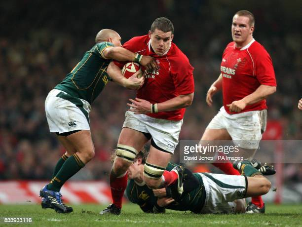 Wales player Ian Evans is tackled by Enrico Januarie and Francois Steyn of South Africa during the Prince William Cup match at the Millennium Stadium...