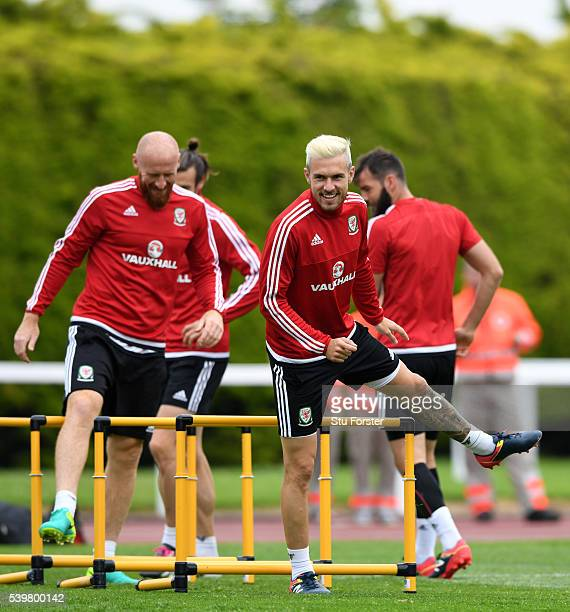 Wales player James Collins shares a joke with Aaron Ramsey during Wales training at their Euro 2016 base camp on June 13 2016 in Dinard France