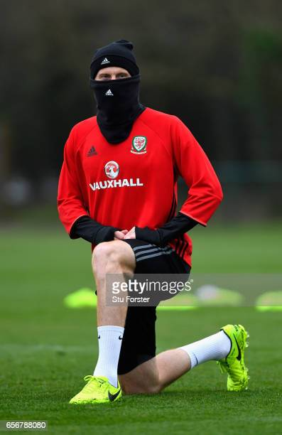 Wales player James Collins wraps up from the cold weather during a Wales Open Training session ahead of their World Cup Qualifier against the...