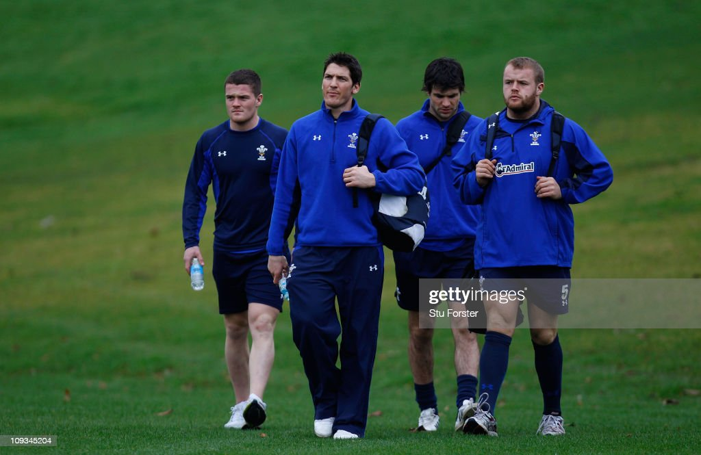 Wales player James Hook (2nd left) turns up for training with team mates for Wales training at the Vale training Complex on February 22, 2011 in Cardiff, Wales.