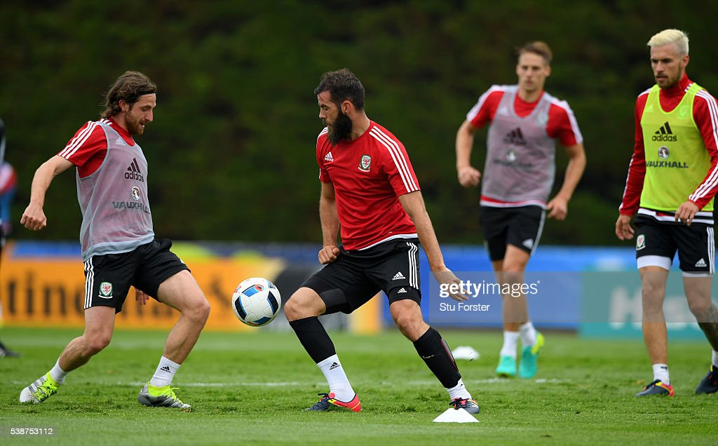 Wales player Joe Allen challenges Joe Ledley during an open Euro 2016 Wales training session at the Wales training base on June 8 2016 in Dinard...