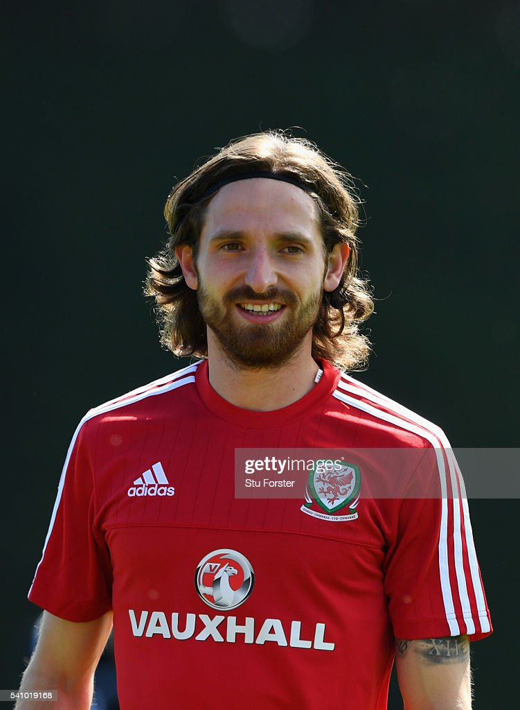 Wales player <a gi-track='captionPersonalityLinkClicked' href=/galleries/search?phrase=Joe+Allen+-+Welsh+Soccer+Player&family=editorial&specificpeople=9629091 ng-click='$event.stopPropagation()'>Joe Allen</a> raises a smile during Wales training at their Euro 2016 basecamp on June 18, 2016 in Dinard, France.