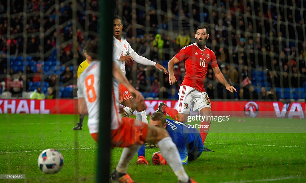 Wales player <a gi-track='captionPersonalityLinkClicked' href=/galleries/search?phrase=Joe+Ledley&family=editorial&specificpeople=687410 ng-click='$event.stopPropagation()'>Joe Ledley</a> scores the first Wales goal during the friendly International match between Wales and Netherlands at Cardiff City Stadium on November 13, 2015 in Cardiff, Wales.