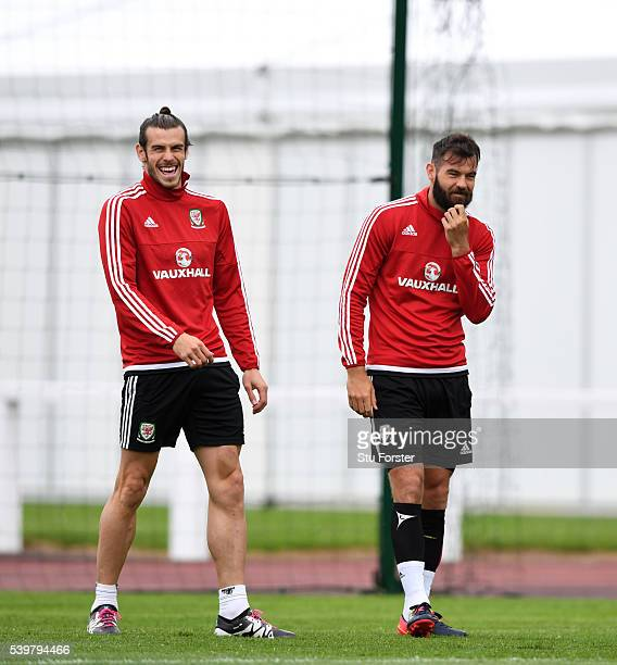 Wales player Joe Ledley shares a joke with Gareth Bale during Wales training at their Euro 2016 base camp on June 13 2016 in Dinard France