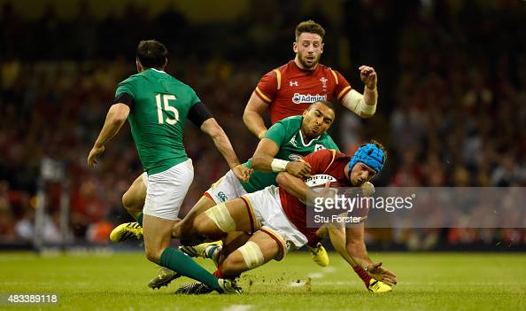 Wales player Justin Tipuric is tackled by Ireland player Simon Zebo during the Rugby World Cup warm up match between Wales and Ireland at Millennium...