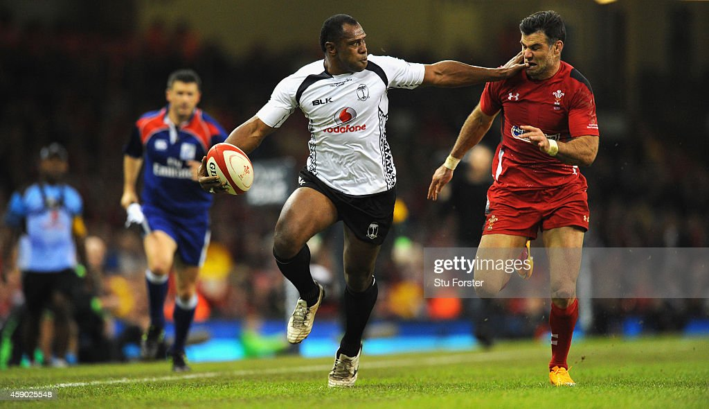 Wales player <a gi-track='captionPersonalityLinkClicked' href=/galleries/search?phrase=Mike+Phillips+-+Rugby+Player&family=editorial&specificpeople=4527917 ng-click='$event.stopPropagation()'>Mike Phillips</a> (r) is fended off by Fiji player <a gi-track='captionPersonalityLinkClicked' href=/galleries/search?phrase=Vereniki+Goneva&family=editorial&specificpeople=4325362 ng-click='$event.stopPropagation()'>Vereniki Goneva</a> during the International match between Wales and Fiji at Millennium Stadium on November 15, 2014 in Cardiff, Wales.