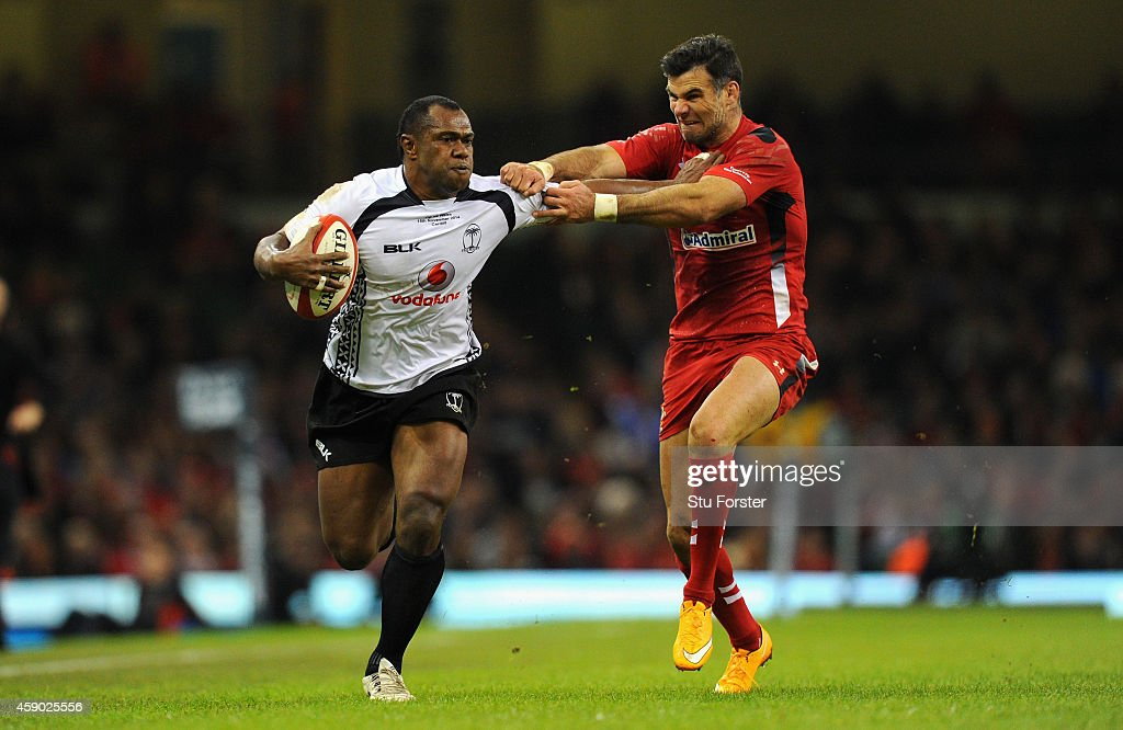 Wales player Mike Phillips (r) is fended off by Fiji player <a gi-track='captionPersonalityLinkClicked' href=/galleries/search?phrase=Vereniki+Goneva&family=editorial&specificpeople=4325362 ng-click='$event.stopPropagation()'>Vereniki Goneva</a> during the International match between Wales and Fiji at Millennium Stadium on November 15, 2014 in Cardiff, Wales.