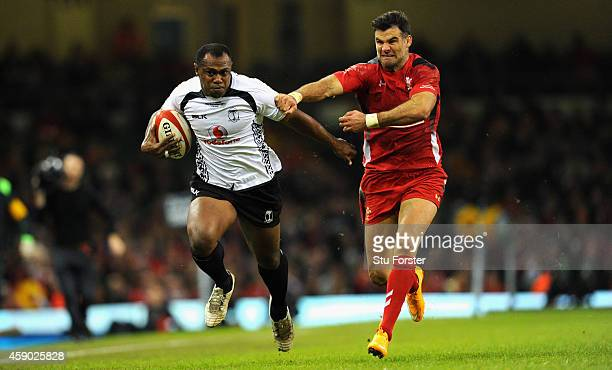 Wales player Mike Phillips is fended off by Fiji player Vereniki Goneva during the International match between Wales and Fiji at Millennium Stadium...