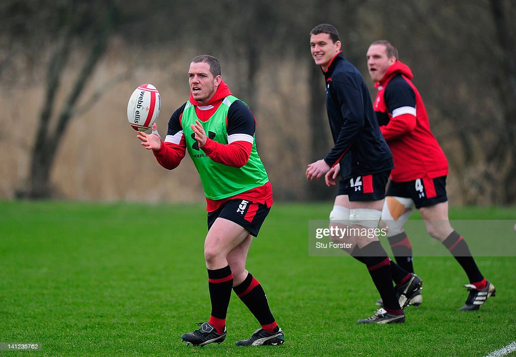 Wales player Paul James (l) prepares to receive the ball during Wales training at the Vale hotel ahead of this saturdays final RBS Six Nations game against France on March 13, 2012 in Cardiff, Wales.
