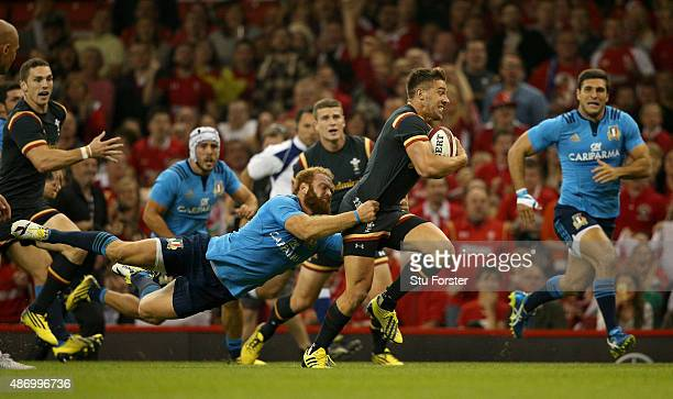 Wales player Rhys Webb breaks the tackle of Gonzalo Garcia of Italy during the International match between Wales and Ireland at Millennium Stadium on...