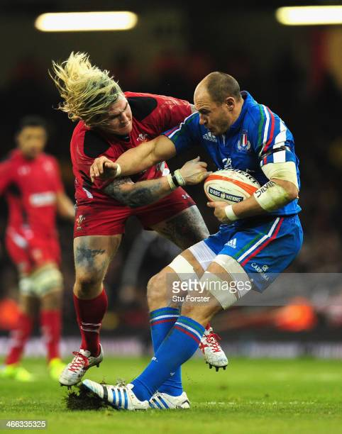 Wales player Richard Hibbard puts in a tackle on Sergio Parisse of Italy during the RBS Six Nations match between Wales and Italy at the Millennium...