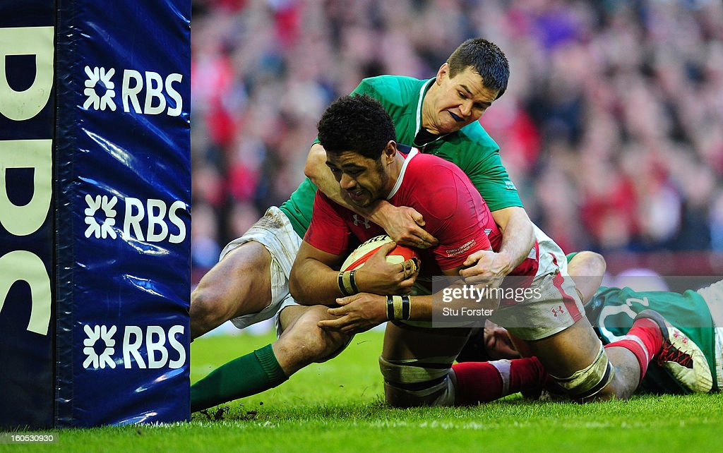 Wales player Toby Faletau is stopped by Jonny Sexton just short of the try line during the RBS Six Nations game between Wales and Ireland at the Millennium Stadium in Cardiff, Wales.