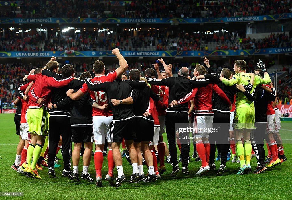 Wales players and staffs celebrate their team's 3-1 win after the UEFA EURO 2016 quarter final match between Wales and Belgium at Stade Pierre-Mauroy on July 1, 2016 in Lille, France.