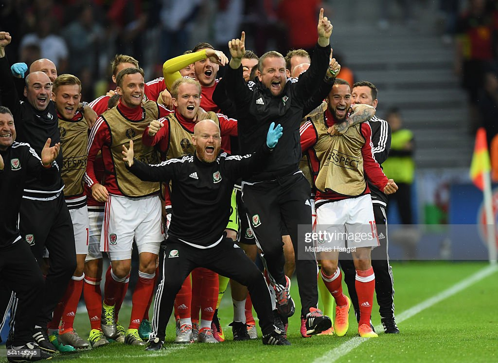 Wales players and team staffs celebrate their team's first goal during the UEFA EURO 2016 quarter final match between Wales and Belgium at Stade Pierre-Mauroy on July 1, 2016 in Lille, France.