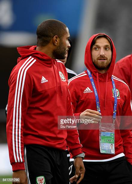 Wales players Ashley Williams and Joe Alen have a chat as they walk round the pitch during Wales training ahead of their Euro 2016 game against...