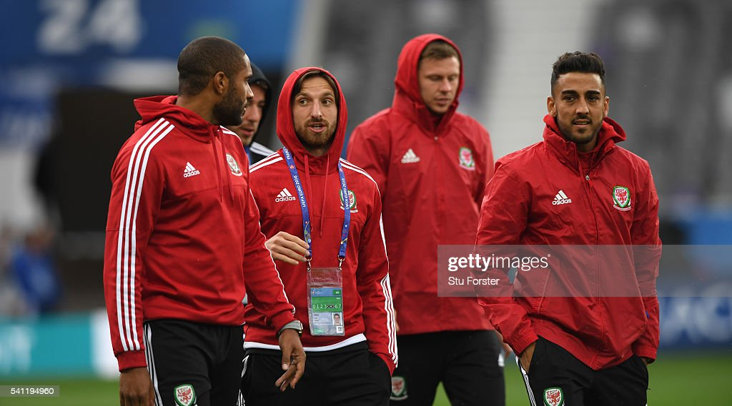 Wales players Ashley Williams Joe Alen and Neil Taylor have a chat as they walk round the pitch during Wales training ahead of their Euro 2016 game...