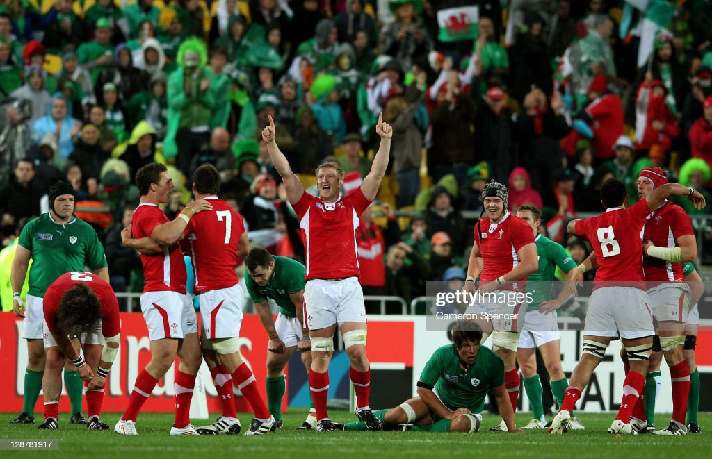 Wales players celebrate their team's 22-10 victory as the final whistle blows during quarter final one of the 2011 IRB Rugby World Cup between Ireland v Wales at Wellington Regional Stadium on October 8, 2011 in Wellington, New Zealand.