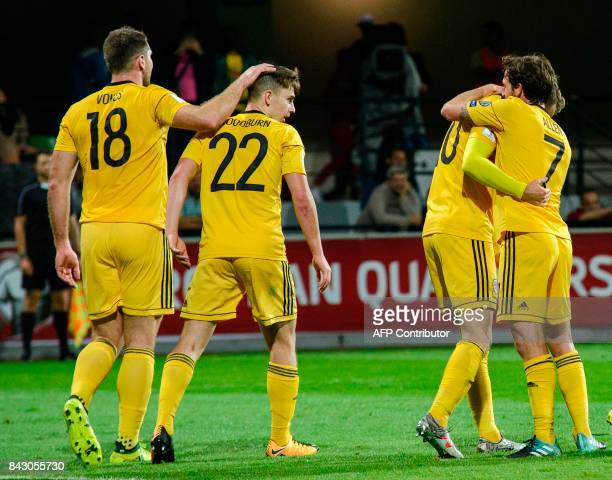 Wales' players celebrate their victory at the end of the FIFA World Cup 2018 group D qualification football match between Moldova and Wales in...