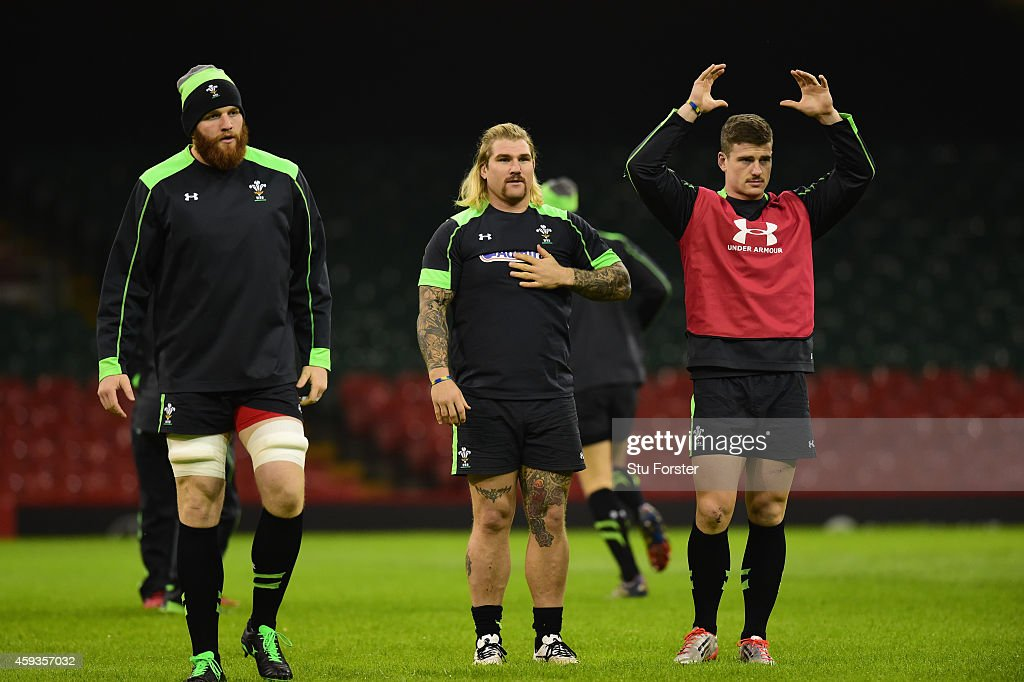 Wales players from left Jake Ball Richard Hibbard and Scott Williams warm up during Wales captains run session ahead of tomorrows match against the...