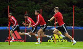 Wales players from left to right Chris Gunter Neil Taylor Hal RobsonKanu and Ben Davies in action during a Euro 2016 Wales training session at the...