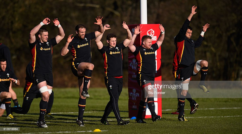 Wales players from left to right Dan Lydiate; Jamie Roberts, Hallam Amos, Samson Lee and captain Sam Warburton raise their hands during the warm up during Wales training ahead of their RBS Six Nations match against France, at The Vale Hotel on February 24, 2016 in Cardiff, Wales.