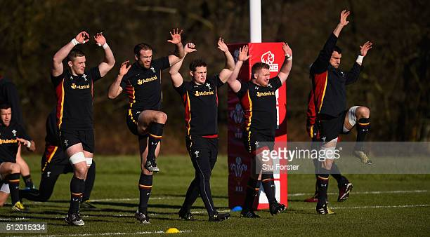 Wales players from left to right Dan Lydiate Jamie Roberts Hallam Amos Samson Lee and captain Sam Warburton raise their hands during the warm up...