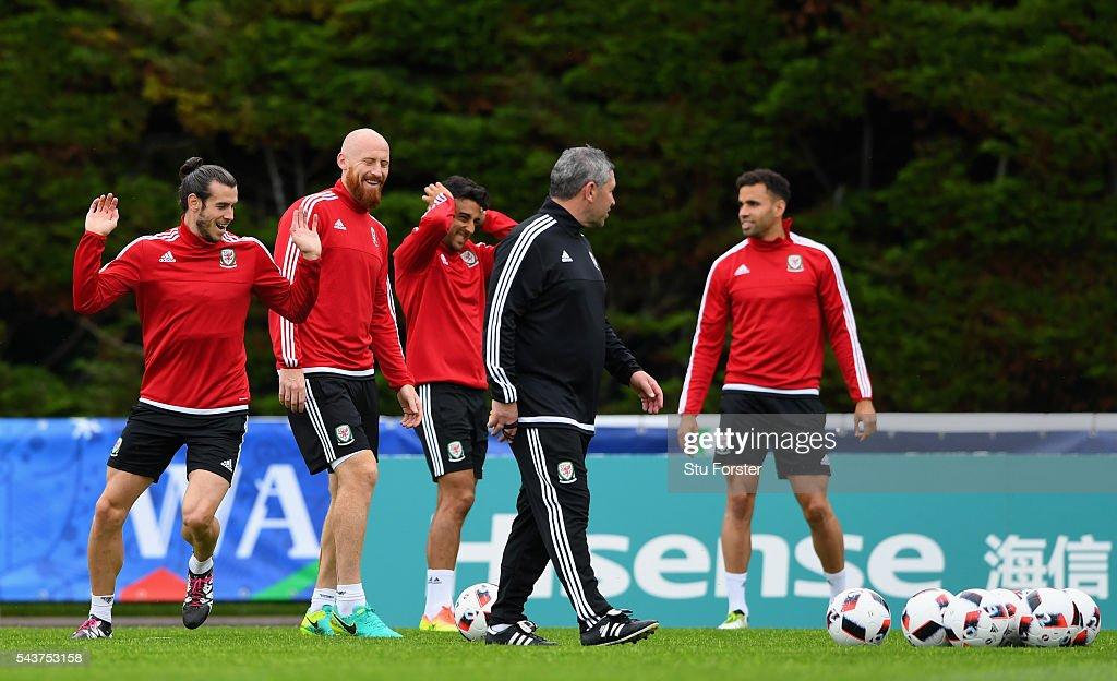 Wales players from left to right, <a gi-track='captionPersonalityLinkClicked' href=/galleries/search?phrase=Gareth+Bale&family=editorial&specificpeople=609290 ng-click='$event.stopPropagation()'>Gareth Bale</a>, James Collins, Neil Taylor and Hal Robson-Kanu share a joke during Wales training session ahead of their Euro 2016 quarter final match against Belgium at their base camp on June 30, 2016 in Lille, France.