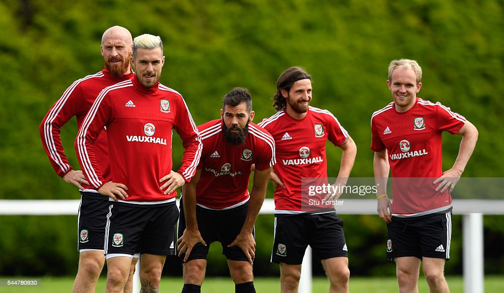 Wales players from left to right James Collins Aaron Ramsey Joe Ledley Joe Allen and Jonny Williams share a joke during Wales training ahead of their...