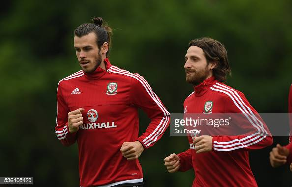 Wales players Gareth Bale and Joe Allen in action during Wales training at the Vale hotel complex on June 1 2016 in Cardiff Wales