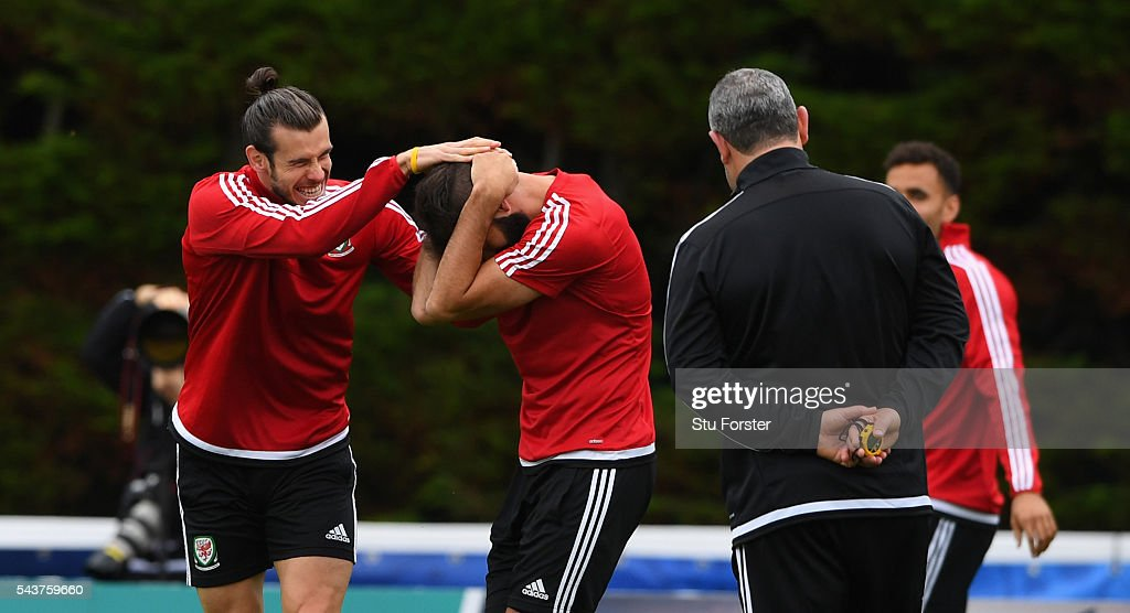 Wales players <a gi-track='captionPersonalityLinkClicked' href=/galleries/search?phrase=Gareth+Bale&family=editorial&specificpeople=609290 ng-click='$event.stopPropagation()'>Gareth Bale</a> (l) and <a gi-track='captionPersonalityLinkClicked' href=/galleries/search?phrase=Joe+Ledley&family=editorial&specificpeople=687410 ng-click='$event.stopPropagation()'>Joe Ledley</a> share a joke during Wales training session ahead of their Euro 2016 quarter final match against Belgium at their base camp on June 30, 2016 in Lille, France.