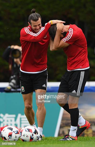Wales players Gareth Bale and Joe Ledley share a joke during Wales training session ahead of their Euro 2016 quarter final match against Belgium at...