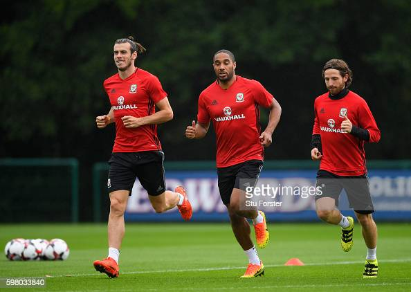 Wales players Gareth Bale Ashley Williams and Joe Allen in action during Wales training ahead of their FIFA World Cup qualifier against Moldova at...