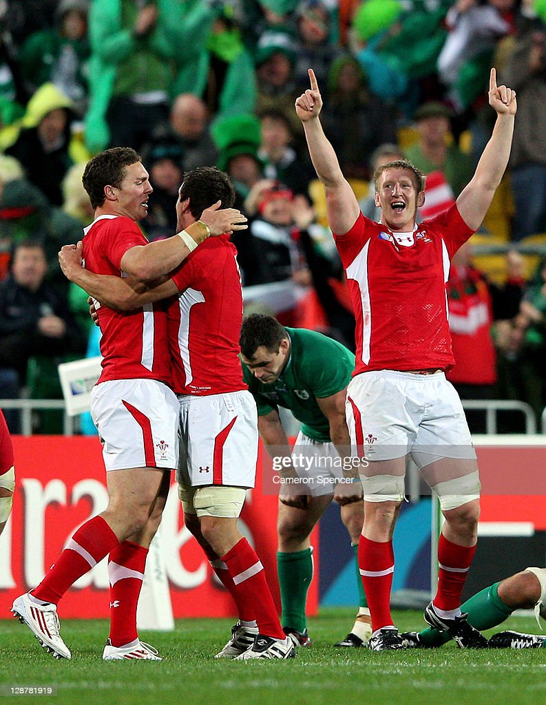 Wales players <a gi-track='captionPersonalityLinkClicked' href=/galleries/search?phrase=George+North&family=editorial&specificpeople=7320853 ng-click='$event.stopPropagation()'>George North</a>, <a gi-track='captionPersonalityLinkClicked' href=/galleries/search?phrase=Sam+Warburton+-+Rugby+Player&family=editorial&specificpeople=4234449 ng-click='$event.stopPropagation()'>Sam Warburton</a> and <a gi-track='captionPersonalityLinkClicked' href=/galleries/search?phrase=Bradley+Davies&family=editorial&specificpeople=677663 ng-click='$event.stopPropagation()'>Bradley Davies</a> celebrate their team's 22-10 victory as the final whistle blows during quarter final one of the 2011 IRB Rugby World Cup between Ireland v Wales at Wellington Regional Stadium on October 8, 2011 in Wellington, New Zealand.
