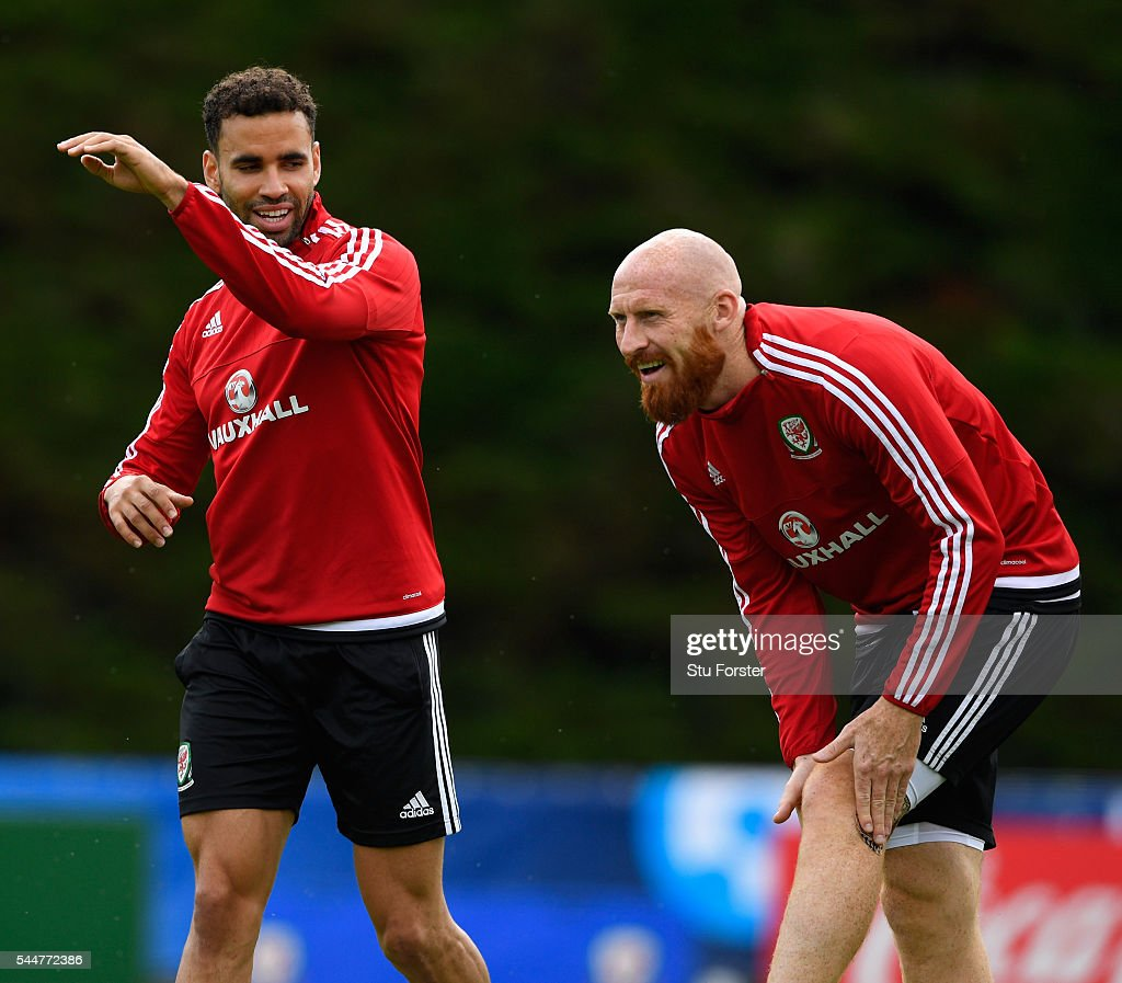 Wales players Hal Robson-Kanu (l) and James Collins share a joke during Wales training ahead of their UEFA Euro 2016 semi final against Portugal at College Le Bocage on July 4, 2016 in Dinard, France.