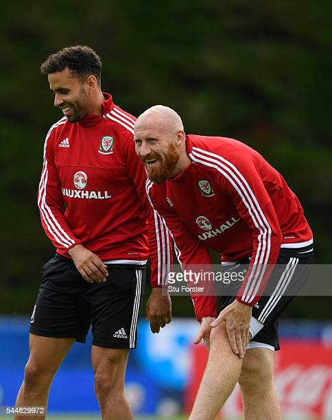 Wales players Hal RobsonKanu and James Collins share a joke during Wales training ahead of their UEFA Euro 2016 semi final against Portugal at...
